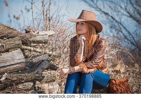Girl In American Country Style Leather Boho Jacket And Cowboy Hat At Nature