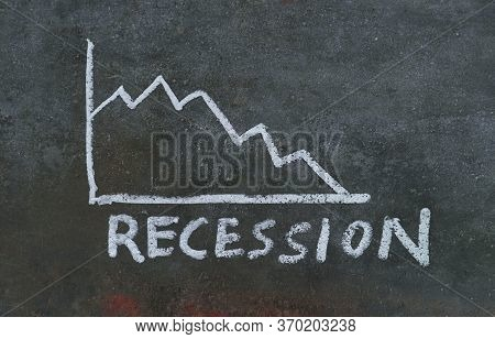 Recession Word With Graph Drawn With White Chalk On Black Surface, Economy Crisis Conceptual Photo