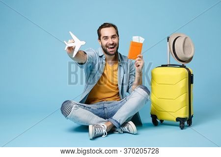 Joyful Traveler Tourist Man In Yellow Clothes Isolated On Blue Background. Passenger Traveling Abroa