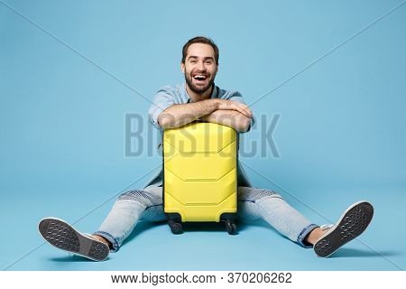 Laughing Traveler Tourist Man In Summer Yellow Casual Clothes Isolated On Blue Wall Background. Male