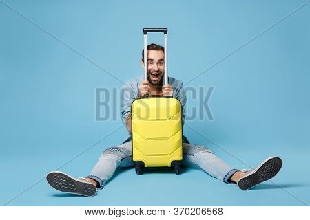 Excited Traveler Tourist Man In Summer Yellow Casual Clothes Isolated On Blue Wall Background. Male
