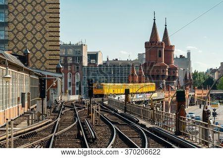 Berlin, Germany - May 18, 2019: Berliner U-Bahn train on Oberbaum Bridge in Berlin, Germany. Friedrichshain Kreuzberg