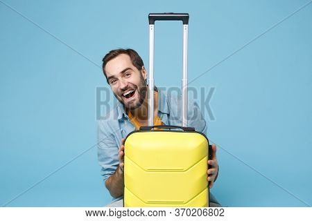 Cheerful Traveler Tourist Man In Summer Yellow Casual Clothes Isolated On Blue Wall Background. Male
