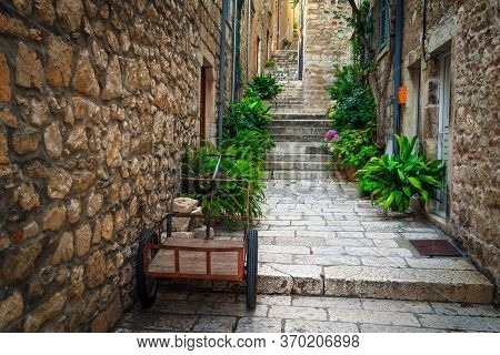Fantastic Narrow Old Street With Stone Houses. Old Town With Rustic Medieval Narrow Street, Hvar Tow