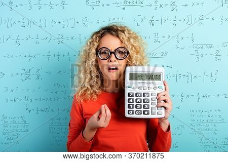 Accountant Girl Has Some Problems With The Sums. Cyan Background