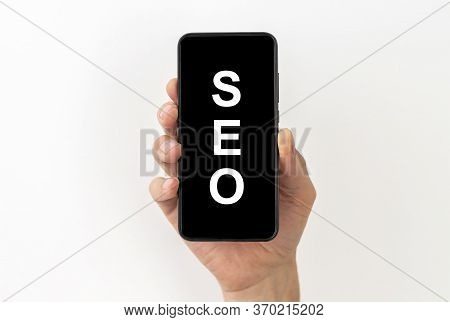Seo Search Engine Optimization Word Acronym Inscription On A Black Screen Of A Mobile Phone In A Mal