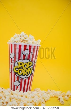 Butter Popcorn In A Red Popcorn Cup, Snack In The House Or Cinema On A Yellow Background