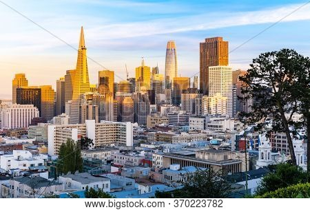 Beautiful Sunset at San Francisco downtown cityscape skylines ans skyscrapers building in California, USA. San Francisco United States Landmark Travel Destination cityscape urban and tourism concept.