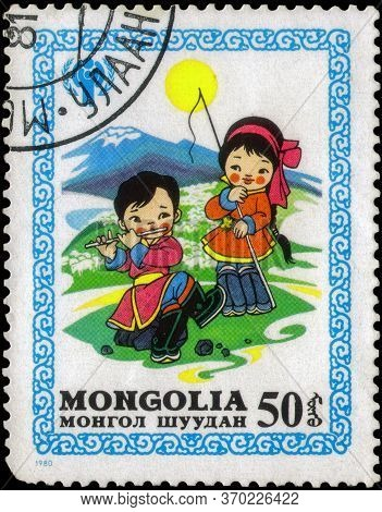 Saint Petersburg, Russia - May 17, 2020: Postage Stamp Issued In Mongolia With The Image Of Children