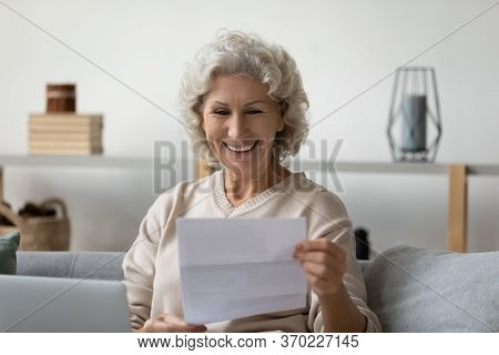 Happy Senior Woman Read Pleasant News In Postal Correspondence
