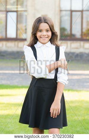 Classy Since Birth. Child At School Break. Fashion And Beauty. Girl Has Curly Hair. Pretty Girl Wear