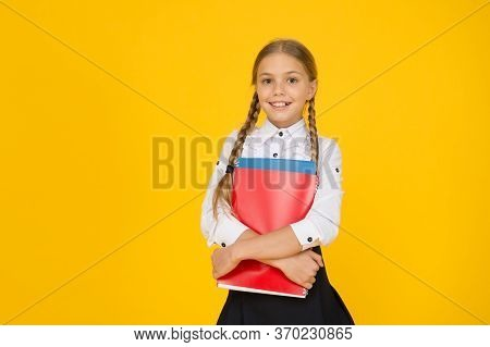 Courses For Gifted Children. Basic Level. Happy Schoolgirl Hold Textbooks Yellow Background. Little