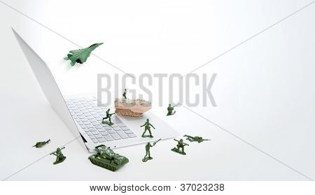 Computer security concept :  soldiers,tank,plane  are guarding a laptop from viruses, spyware and hacker