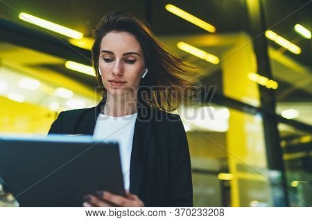 Successful Female Banker Using Tablet Outdoors While Standing Near His Office Background Yellow Neon