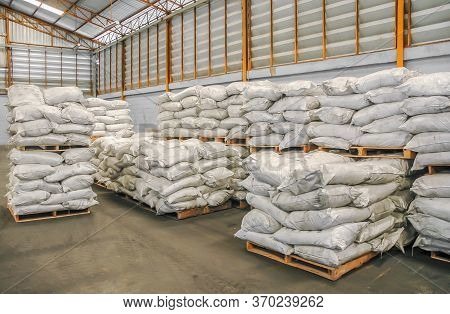 Storehouse With Stacked Sacks Of Chemical Product.