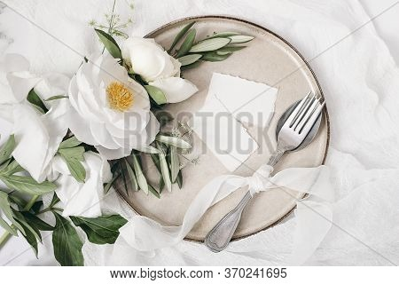 Festive Summer Wedding Scene. Marble Table Setting With Cutlery, Olive Branches, White Peony Flowers