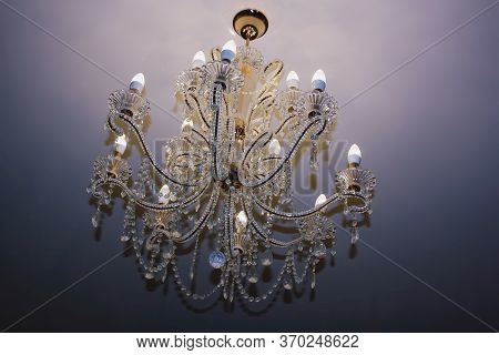 Beautiful Magnificent Chandelier On The Ceiling. Closeup.