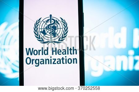 World Health Organization Logo On The Smartphone Screen In Hand. High Quality Photo