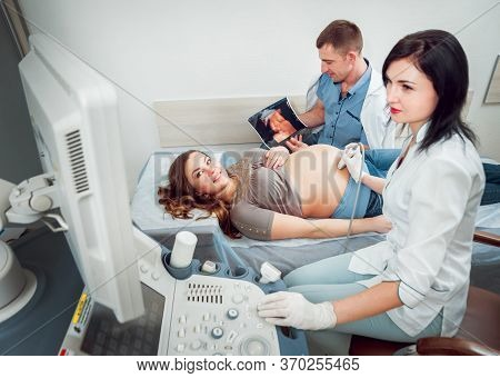 Doctor And Patient. Ultrasound Equipment. Diagnostics And Sonography
