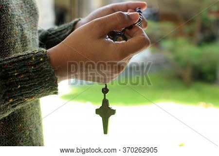 Young Lady Prayer Hand Holding Rosary Beads With Jesus Christ Holy Cross Crucifix. Praying The Rosar