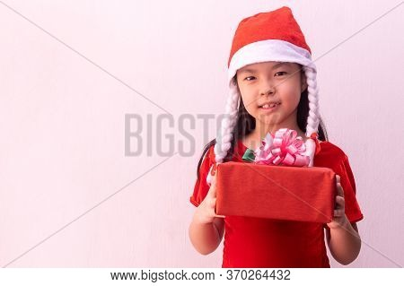 Asian Girl In Elf Clothes Holding Gift. Merry Christmas