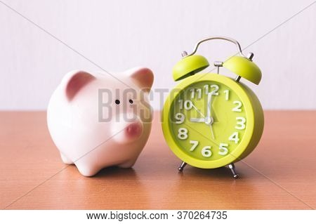 Piggy Bank, Alarm Clock And Coins. For Growing Business. Time To Saving Concept.