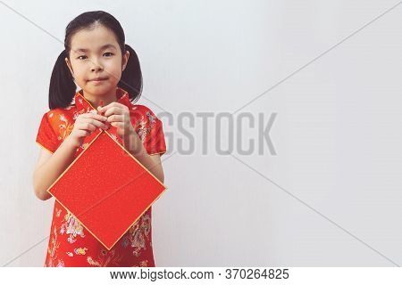 Asian Girl Wear Cheongsam And Holding Blank Rep Paper