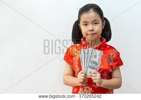 Asian Girl Wear Cheongsam And Take Banknote In Chinese New Year