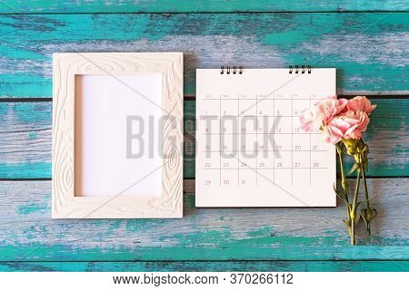 Carnation Flower On Blank Picture Frame And Calendar On Wood Background, Valentine's Day, Mother's D