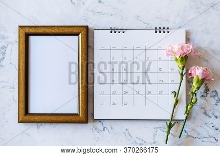 Carnation Flower On Blank Picture Frame And Calendar On Marble Background, Valentine's Day, Mother's