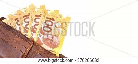 Canadian Dollars In A Leather Wallet On White Background,copy Space