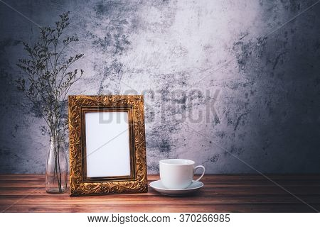 Picture Frame And Flowers And Coffee Mugs On Wooden Table. Poster Product Design Styled