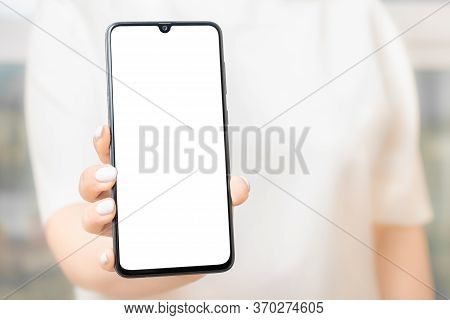 Mockup Image Of A Woman Holding And Showing Black Mobile Phone With Blank Screen. Women Hand Show Th