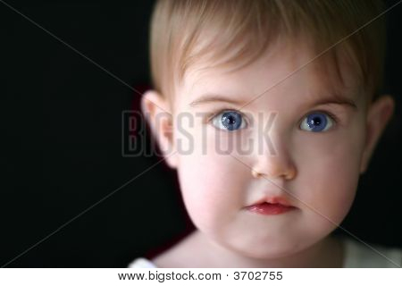 Soft Focus Picture Of An Adorable Toddler Girl