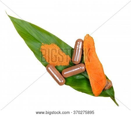 Turmeric Root Powder, Curcuma Root, Turmeric Capsule On Leaf; White Background.herb High Vitamin C.