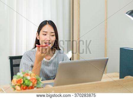 Beautiful Young Asian Woman Using Video Conference And Call To People,work From Home,work At Home
