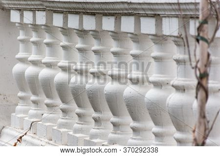 Pattern Of White Balusters. Architectural Elements Of Stairs And Railings. Beautiful Repeating Patte