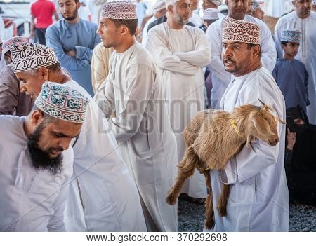Nizwa, Oman, December 2, 2016: Goat sellers at the Friday goat market in Nizwa, Oman