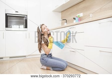 Happy Woman Cleaning Home, Singing . Housework, Chores Concept.girl Cleaning The House. House Cleani