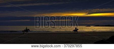 Cornish Sunset With Horse Riders - St Ives, Cornwall, Uk