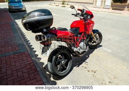 Torrevieja, Valenciana, Spain - June 07 2020 : Ducati Multistrada 1100 S Motorbike, In Red, Parked I