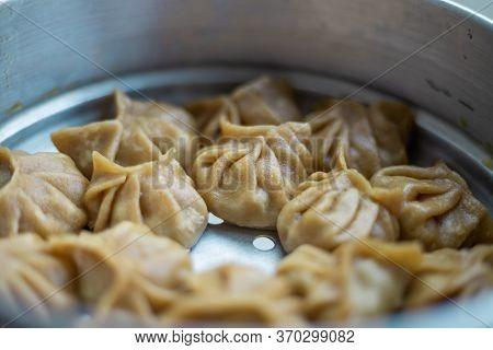 Top View Of Chicken Momo Dumplings Dimsum Snacks. Delicious Homemade Food.