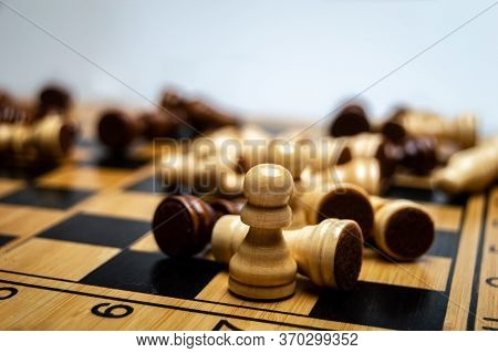 The Chess Pieces Fell On The Chessboard In Disarray