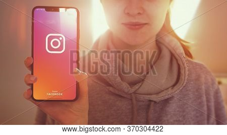 Kyiv, Ukraine-january, 2020: Instagram On Mobile Phone Screen. Young Girl Showing Smart Phone Screen