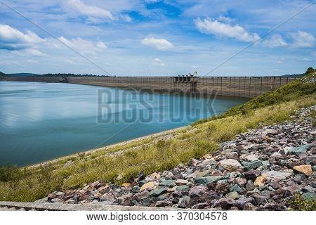 View Of Khun Dan Prakan Chon Dam On Mountain Range Next To Deep River At Nakhon Nayok, Thailand. Rol