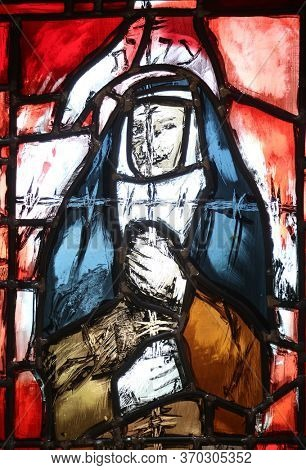PIFLAS, GERMANY - JUNE 07, 2015: Saint Edith Stein, stained glass window by Sieger Koder in St. John church in Piflas, Germany
