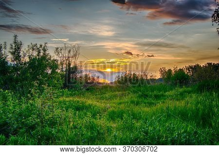 Sunset Over A Bright Green Glade In Hdr Quality