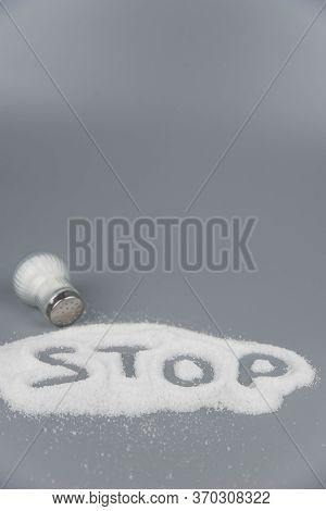 A Pile Of Salt From Salt Shaker, Lettering With Word Stop Salt, Concept Excessive Salt Intake And Wh