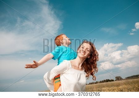 mom with a son on his shoulders