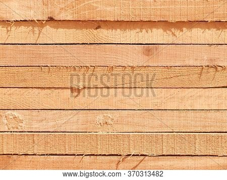 Stack Of Lumber Boards Background Or Texture Concept